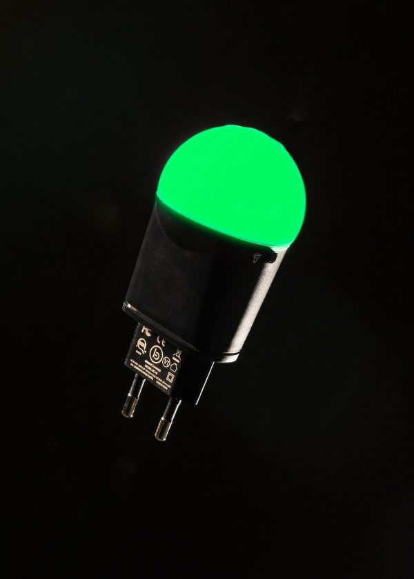 Black BrightCharger emitting green light